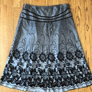 Stunning silver, black skirt